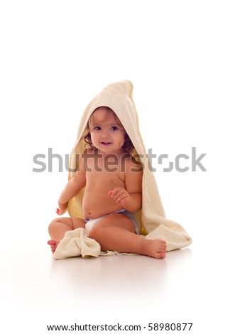 Baby girl in a bath towel isolated on white background