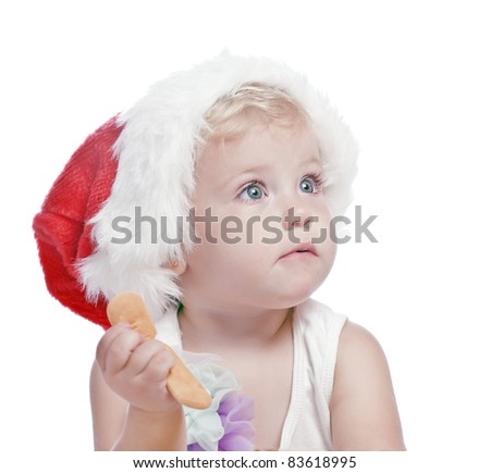 baby girl in a red new year cap