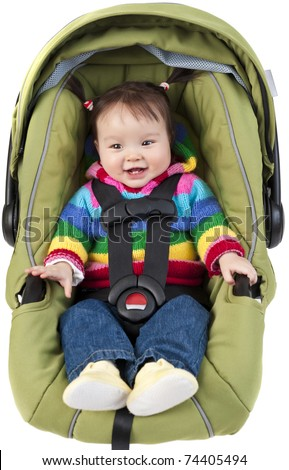 Baby girl in car seat isolated on white