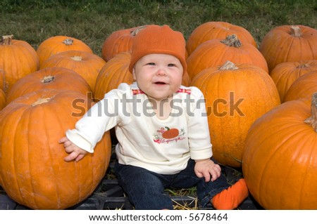 Baby Girl in Pumpkin Patch