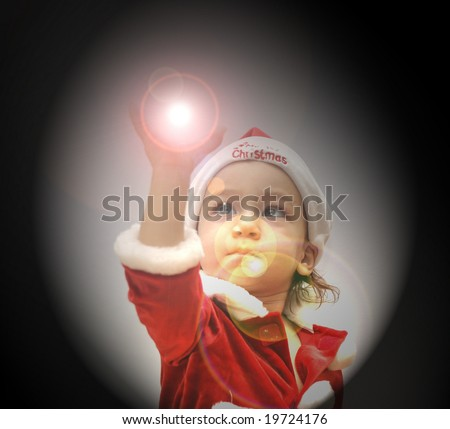 Baby Girl In Red Santa Suit Holds up Glowing Snow Globe