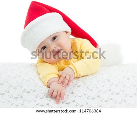 Baby girl in Santa's hat on white background