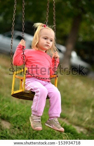 Baby girl in swing