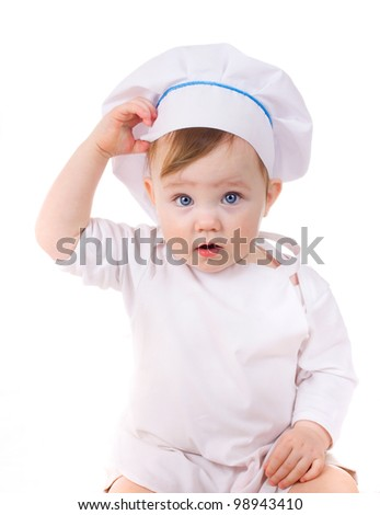 Baby girl in the cook hat isolated on white background