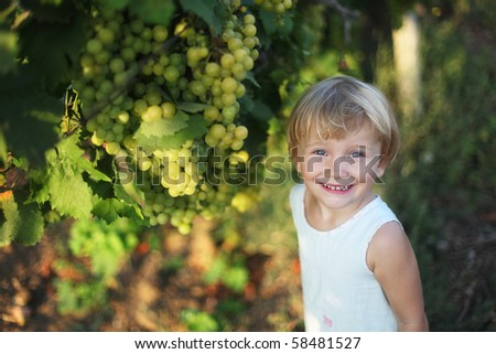 Baby girl in vineyard