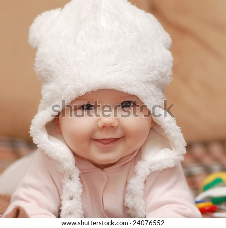 Baby girl in white hat