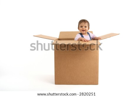 baby girl inside box, laughing