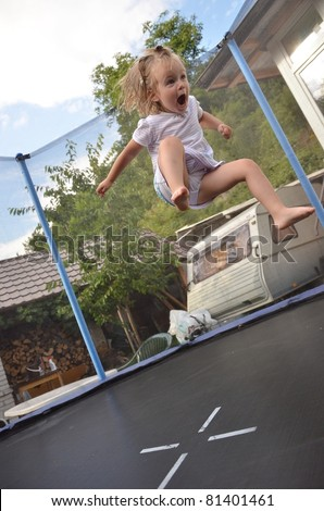 Baby Girl Jumping On Trampoline Stock Photo 81401461