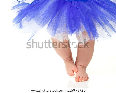 baby girl like a ballet dancer in blue tutu, isolated on white background