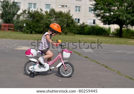 baby girl on bike