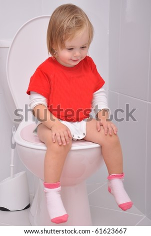 baby girl on the toilet