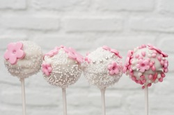 baby girl pink cakepops with flower decoration, pearls and rusk