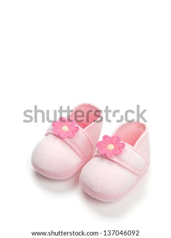 Baby girl pink shoes isolated on white background