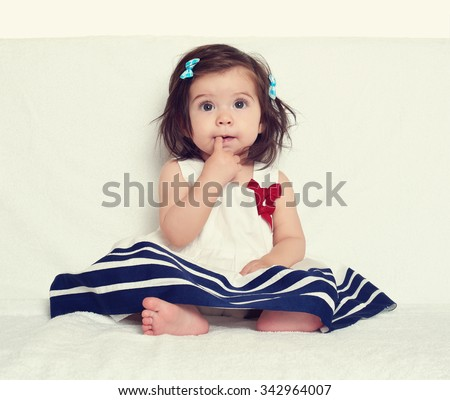 baby girl portrait, sit on white towel #342964007