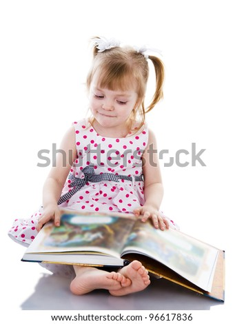 baby girl reading a book. isolated on white background