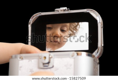baby girl reflection in the mirror of jewellery or cosmetics box, isolated