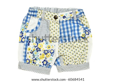 baby girl's shorts on over the white background