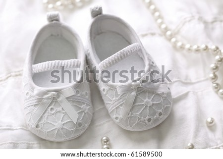 Baby girl shoes on white background - stock photo