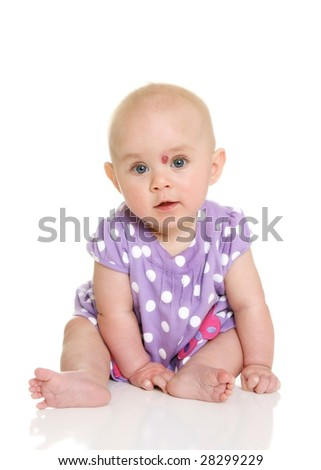 Baby Girl sitting Looking at Camera