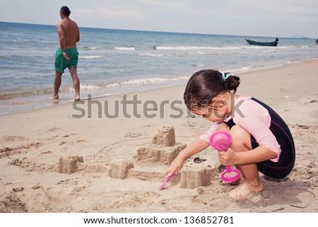 Baby girl sitting on a beach