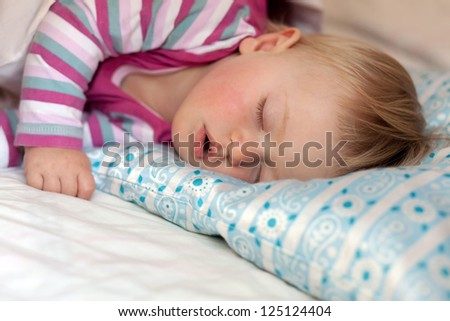 baby girl sleeping on a pillow