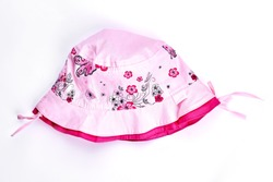 Baby-girl summer pink hat. Infant girl light pink flower print panama isolated on white background. Childs brand summer headwear on sale.