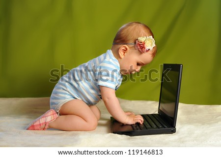 Baby girl surfing the web (using PC)