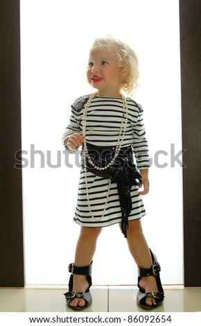 stock photo : baby girl with adult accessories playing in home