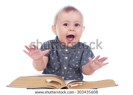 Baby girl with book sitting on white background #303435608