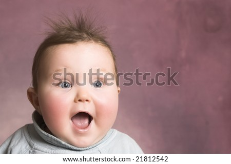 Stock Photo Baby girl with chubby cheeks and beautiful facial expressions