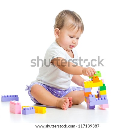 baby girl with construction set isolated on white background
