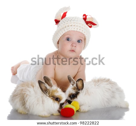 baby girl with easter eggs and cute easter bunny