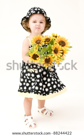 baby girl with flowers - stock photo