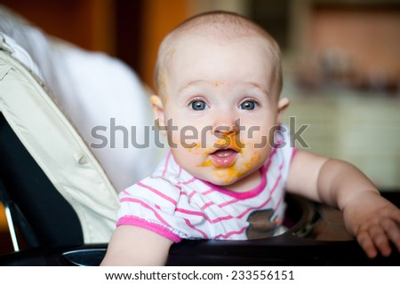 Baby girl with food on her face #233556151
