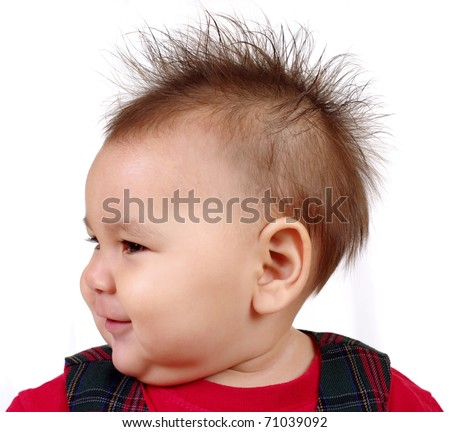 baby girl with funny spiky hair, on white background