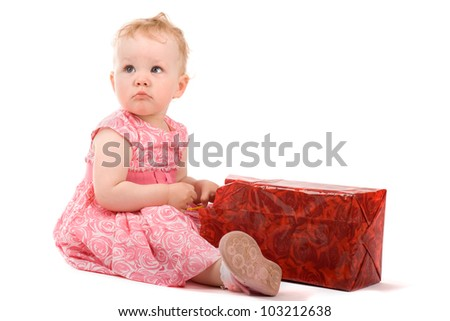 Baby girl with gift box