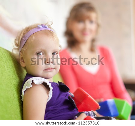 baby girl with mother in home interior
