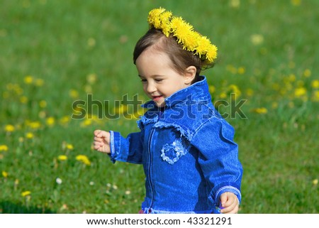 Baby girl with spring wreath
