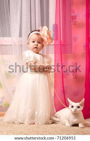 baby girl with the cat