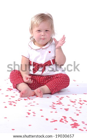 Baby girl with valentine's day hearts