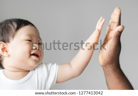 Baby giving a high five