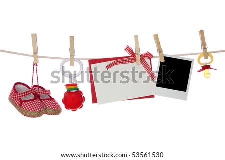 Baby goods,photo and blank note hanging on the clothesline
