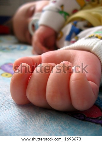 baby hand;  baby sweet dream on colourful blanket;