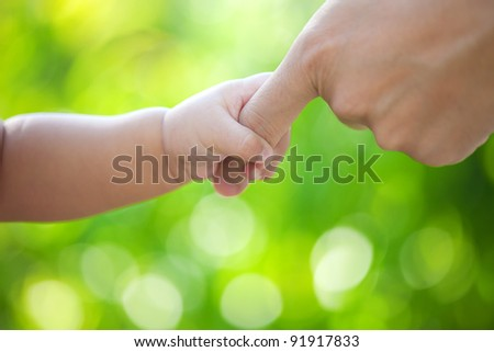 Baby hand hold father hand