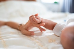 Baby hand in mother hand concept of love and Happiness of maternity