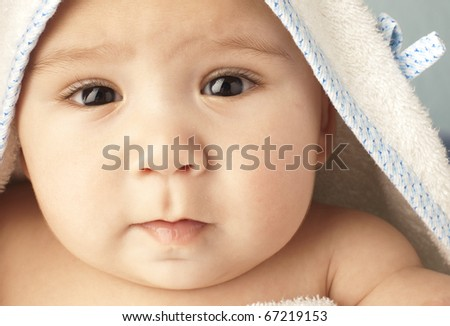 baby happy before a bath, extreme closeup