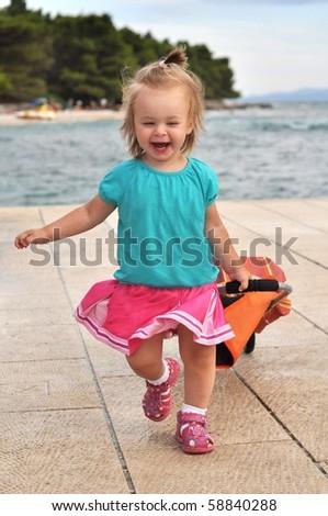 baby having fun on the beach