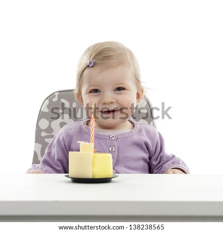 baby having her first birthday, isolated on white background - stock photo
