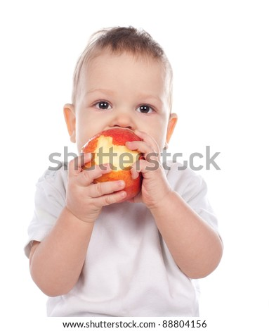 Baby holding and eating an apple isolated on white background