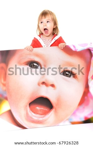 baby holding poster